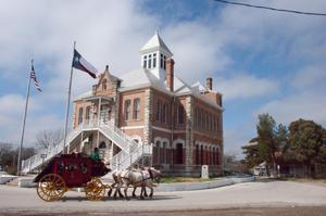 Primary view of object titled '[Carriage Driving Past Courthouse]'.