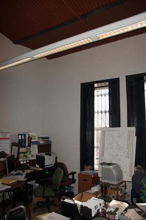 Primary view of object titled '[Photograph of a Cluttered Office]'.