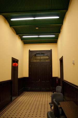 Primary view of object titled '[Doors at End of Hallway]'.