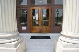 Primary view of object titled '[Front Courthouse Doors]'.