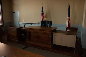 Primary view of object titled '[Photograph of Judge's Bench]'.