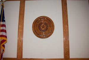 Primary view of object titled '[Wooden Plaque on a Wall]'.