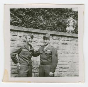 Primary view of object titled '[Davis Matter and Carl Zutz by a Wall]'.