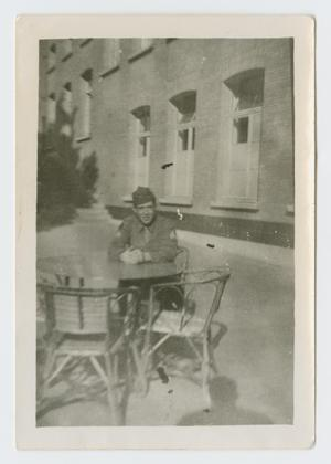 Primary view of object titled '[Soldier at Cafe Table]'.