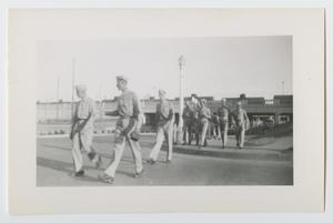 Primary view of object titled '[Soldiers Walking in Town]'.
