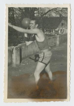 Primary view of object titled '[Wampler Throwing Basketball]'.