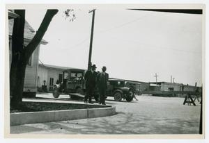 Primary view of object titled '[Photograph of Men on a Sidewalk]'.