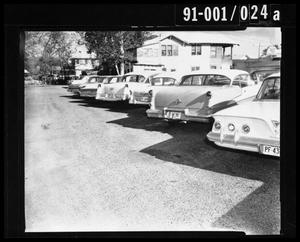 Primary view of object titled '[Row of Cars in Parking Lot [Negative]]'.