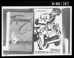 Primary view of object titled '[Photograph of Two Russian Booklets Removed from Oswald's Home]'.