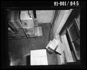 Primary view of object titled '[Boxes in theTexas School Book Depository]'.