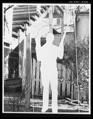 Primary view of object titled 'Figure in Backyard of 214 Neeley Street #1'.
