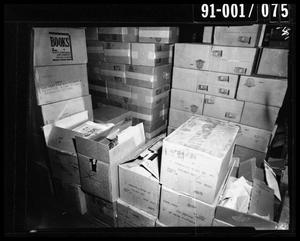 Primary view of object titled 'Boxes at the Texas School Book Depository [Negative]'.
