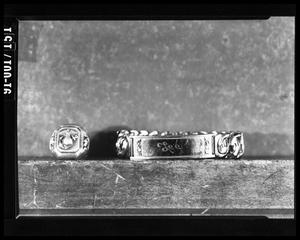 Primary view of object titled 'Oswald's Ring and ID Bracelet'.