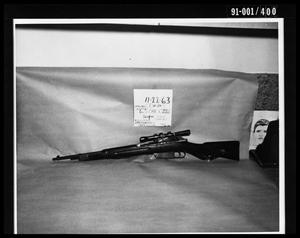 Primary view of object titled 'Evidence: Rifle and Police Artist Sketch [Print]'.