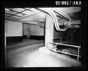 Primary view of object titled 'City Hall Basement, Southeast Door to Jail and Main Street [Negative]'.