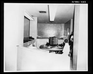 Primary view of object titled 'City Hall Jail Office, Looking East from Front of Jail Elevator [Print]'.