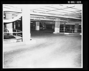 Primary view of object titled 'City Hall Basement with Dallas Police Department Vehicle [Print]'.