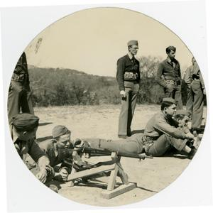Primary view of object titled 'Men Practicing Shooting While Others Watch'.