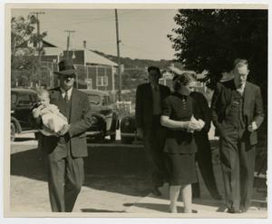 Primary view of object titled 'People in Black on a Sidewalk, Coach Weir Carrying a Baby'.