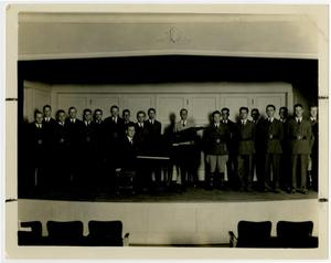 Primary view of object titled 'Choir Group on Auditoriam Stage with Piano and Pianist'.