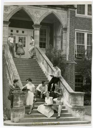 Primary view of object titled 'Students Talking and Studying on the Steps of the Admin. Building (Weir)'.