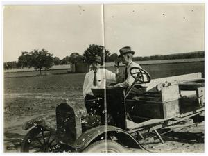 Primary view of object titled 'C.O. Forgy (in car) and M.A. Howell at Schreiner Institute, May 17, 1923'.