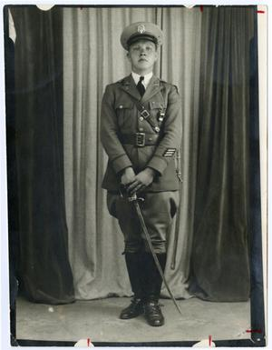 Primary view of object titled 'Portrait of Cadet In Uniform with Sword'.