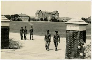 Primary view of object titled 'Men in Uniform Walking out of the Front Entrance'.