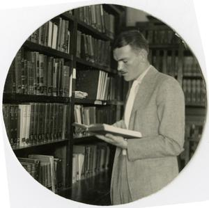 Primary view of object titled 'Man in the Library Reading a Book'.