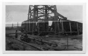 Primary view of object titled 'Gulf Oil Workers and Well'.