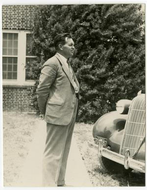 Primary view of object titled 'R.C. Dickey Standing Next to a Car'.