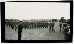 Primary view of object titled 'Men in Dress Uniform at Attention with Swards in a Field'.