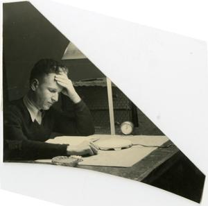 Primary view of object titled 'Man Studying by Lamplight'.
