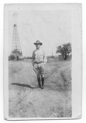 Primary view of object titled 'Man by Drilling Rig'.