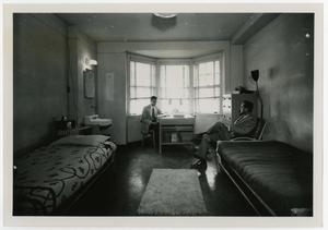 Primary view of object titled 'Two Men Sitting in a Dorm Room'.