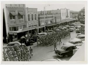Primary view of object titled 'Schreiner Cadets Marching on Parade in Kerrville'.