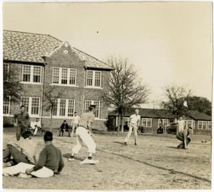 Primary view of object titled 'Young Men in a Football Play with Others Watching'.