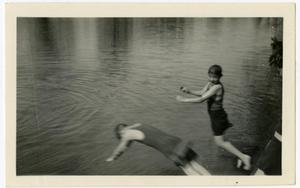 Primary view of object titled 'Evilyn and Lige Emmerson Jumping into the Guadalupe River, April 29, 1923'.