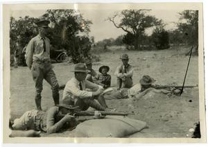 Primary view of object titled 'Five Men Watching Two Men Shoot Their Rifles from the Ground'.