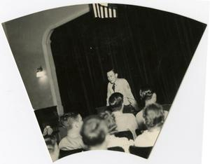 Primary view of object titled 'A Young Man Giving a Speech to a Crowd in the Auditorium'.