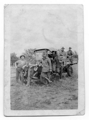 Primary view of object titled 'Gulf Oil Workers by Truck'.