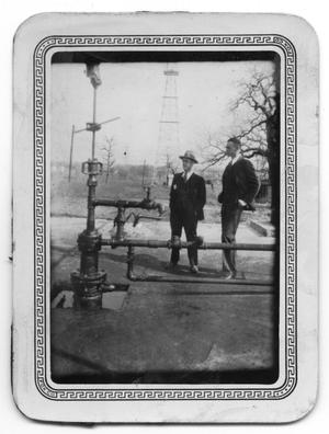 Primary view of object titled 'Shell Oil Workers Inspecting Pipe'.