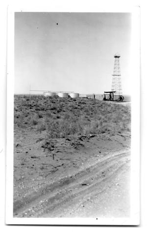 Primary view of object titled 'Oil Well and Tanks in New Mexico'.