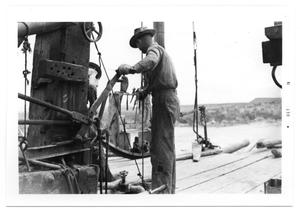 Primary view of object titled 'Man Works on Rig'.
