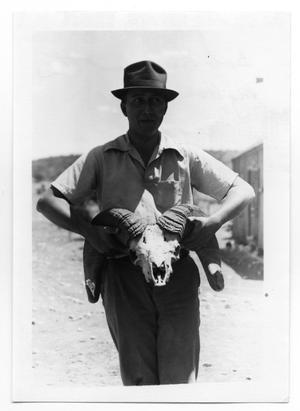 Primary view of object titled 'Bob King Holding Skull'.