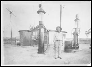 Primary view of object titled 'Man at Gas Station'.