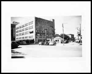 Primary view of object titled 'Exterior View of Hemphill Wells Department Store and Moutray Oil Service Station'.
