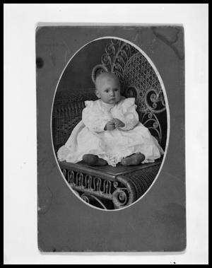 Primary view of object titled 'Portrait of Unknown Child Posing in Dress on Wicker Chair'.