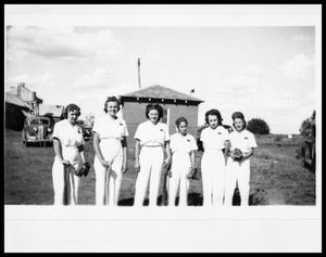 Primary view of object titled 'Women's Softball Team; Automobiles in Background'.