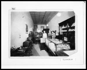 Primary view of object titled 'Interior View of Store Front, Cox Typewriter Exchange and Staff'.